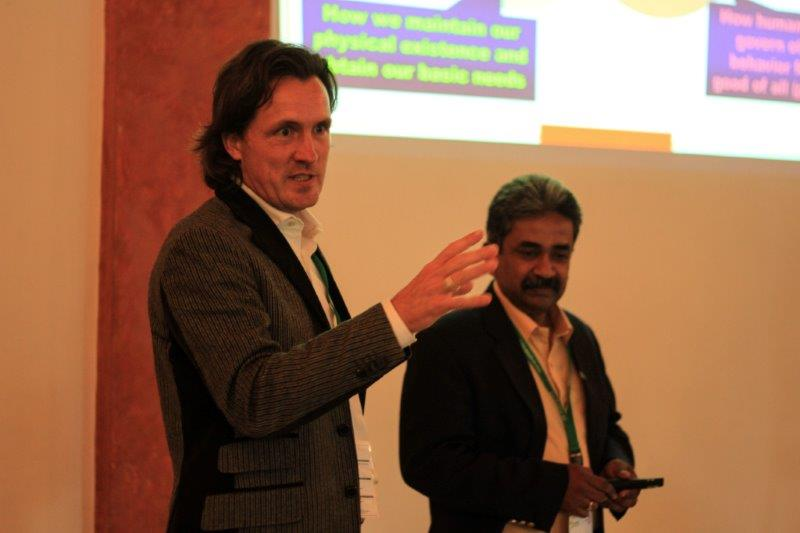 Trans4m's Co-Founder Prof. Alexander Schieffer (in 2013, at the 1st International Conference for Integral Green Economy in Slovenia, with Sarvodaya's Secretary General Dr. Vinya Ariyaratne)