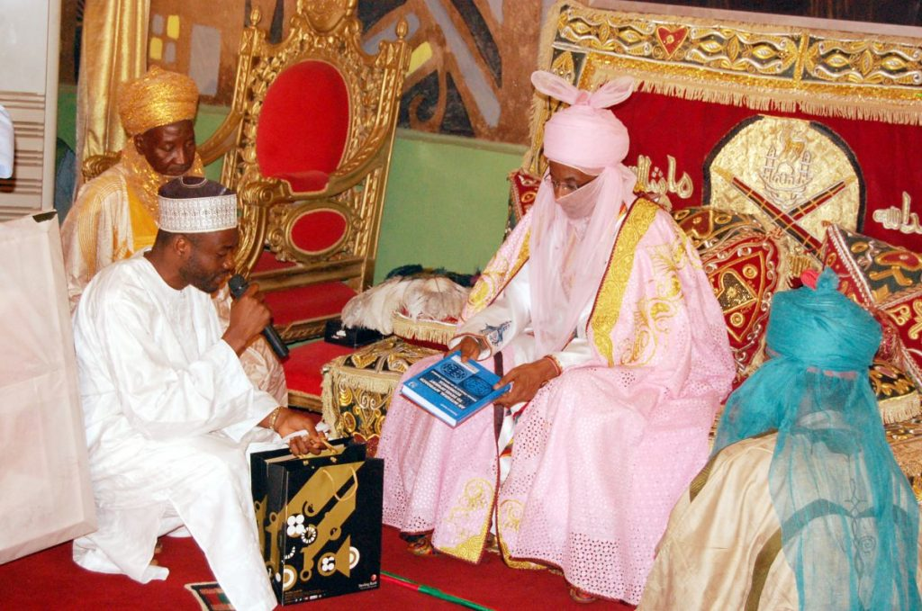 Basheer Oshodi presenting the book to the Emir of Kano, Nigeria