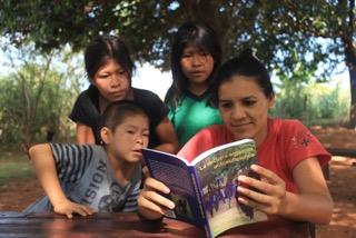 Fundacion Paraguaya An alumni of Cerrito looking at the book written by Martín Burt