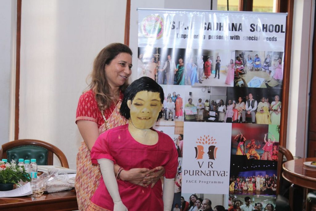 Dr. Khanna with a puppet, representing Vasudha - with her began the story of S.P.J. Sadhana School