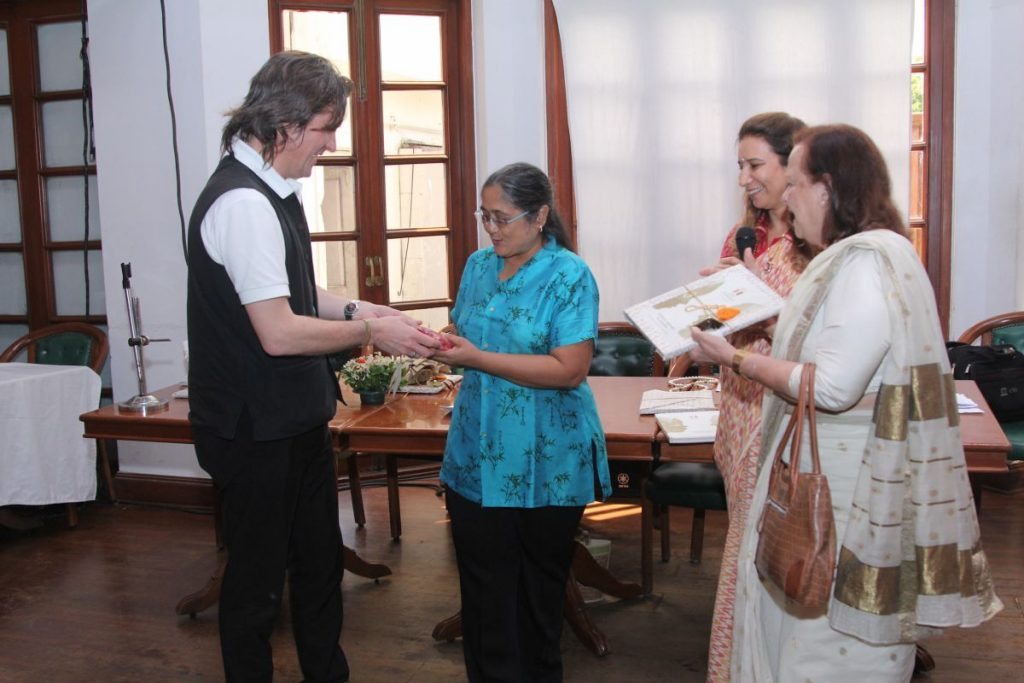 Archana from Om Creations is congratulated for her Contributions to the Book Launch