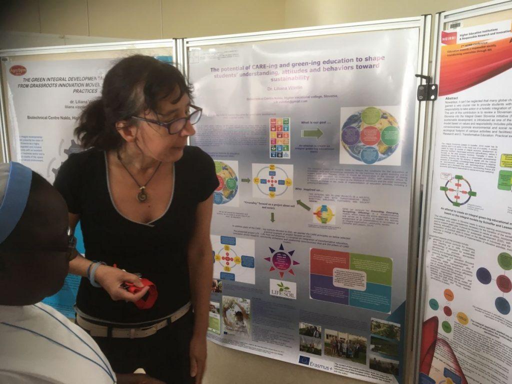 2018 09 11 Slovenia BC Naklo PhD Module Cohort 5 Liliana Explaining Posters 2 Sister Esther