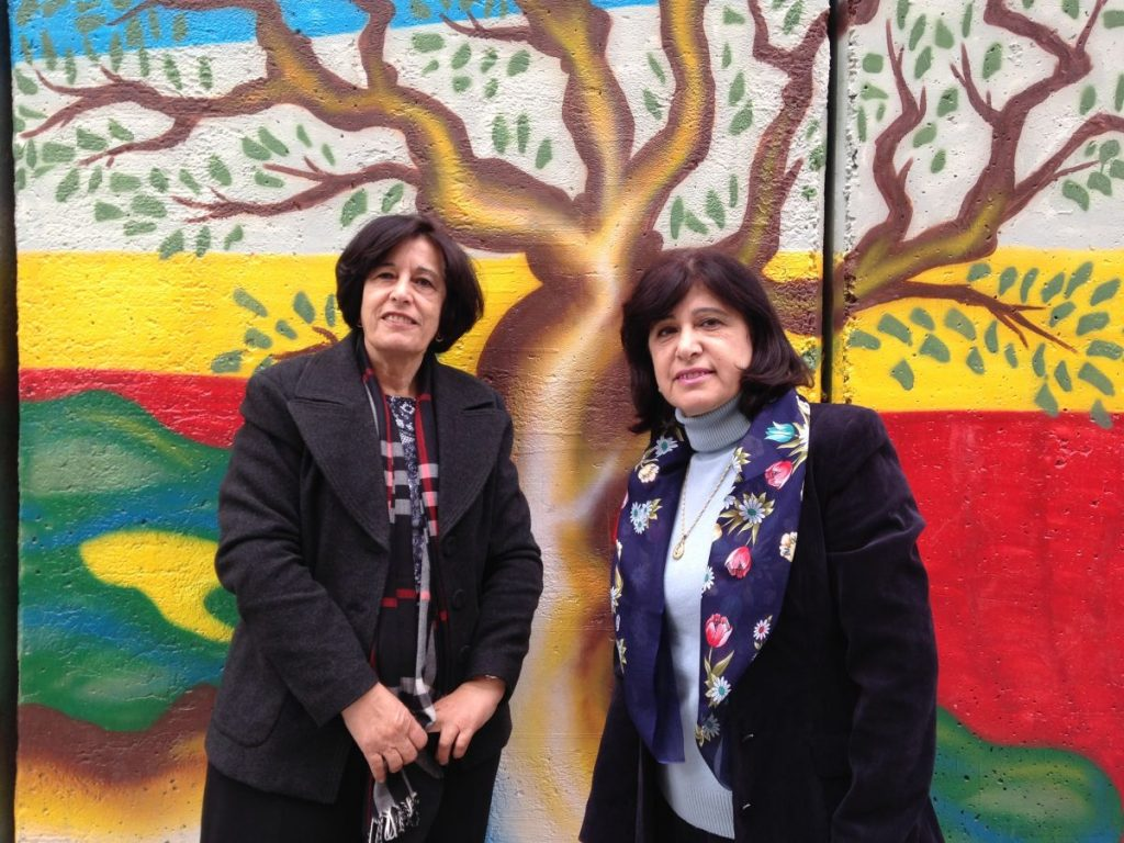 Zahira & Rada in front of Wall separating Palestine