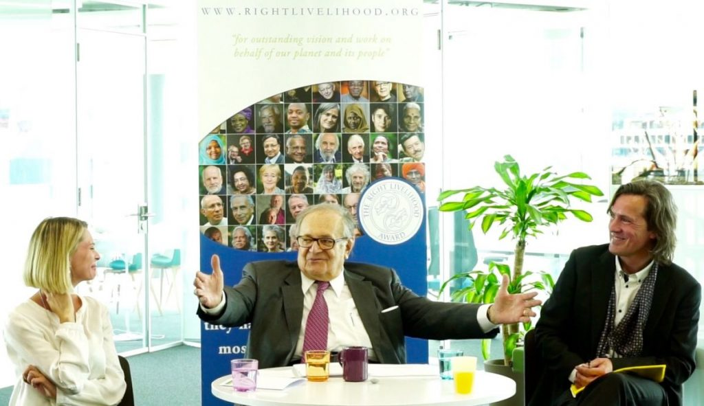 "Extract from the film ""Integral Development Journey""; Xenya Cherny-Scanlon (Right Livelihood Award), Cornelio Sommaruga (former President of ICRC) and Alexander Schieffer (from left to right) at the Right Livelihood Foundation Office in Geneva (Maison de la Paix)"