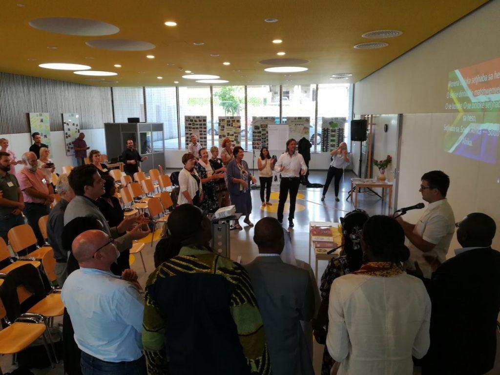 2018 09 13 Slovenia Slovenska Bistrica IGS Conference Alexander Talk Singing Hymn